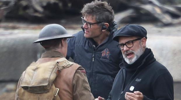 Director Sam Mendes and George MacKay on the set of 1917 at Govan Docks in Glasgow (Andrew Milligan/PA)