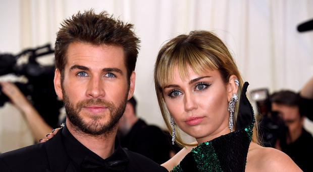 Liam Hemsworth said he wishes wife Miley Cyrus 'nothing but health and happiness' following their split (Jennifer Graylock/PA)