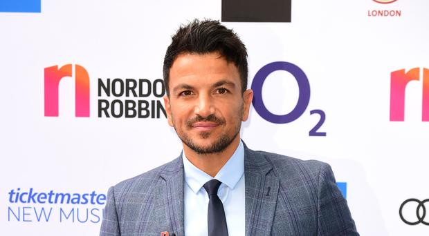 Peter Andre surprised his wife. (Ian West/PA)