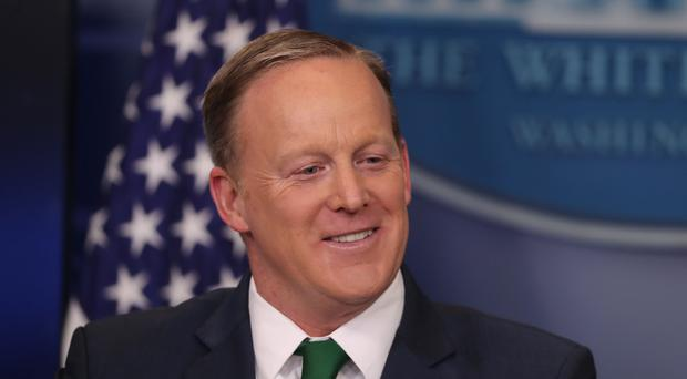 Donald Trump's former press secretary made his Dancing With The Stars debut while performing the salsa wearing a neon green ruffled shirt (Niall Carson/PA)