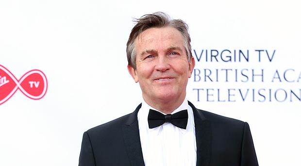 Bradley Walsh said he 'can't wait to cheer up the nation with Holly at my side' (Isabel Infantes/PA)