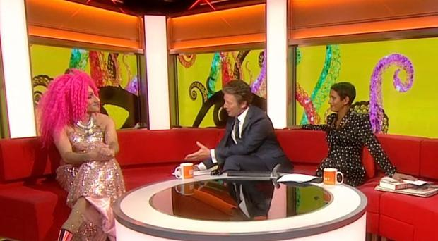 BEST QUALITY AVAILABLE Screen grab dated 04/10/2019 taken from BBC Breakfast showing Amrou Al-Kadhi (left), Charlie Stayt (centre), and Naga Munchetty (right). Eton educated, Cambridge graduate, author, and drag queen, Amrou whilst being interviewed on this morning's BBC Breakfast expressed solidarity and support to presenter Naga Munchetty who thanked the drag artist.