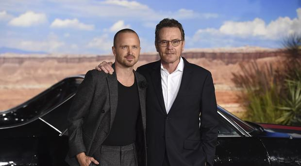 "Cast members Aaron Paul, left, and Bryan Cranston arrive at the Los Angeles premiere of ""El Camino: A Breaking Bad Movie,"" at the Regency Village Theatre, Monday, Oct. 7, 2019, in Westwood, Calif. (Photo by Jordan Strauss/Invision/AP)"