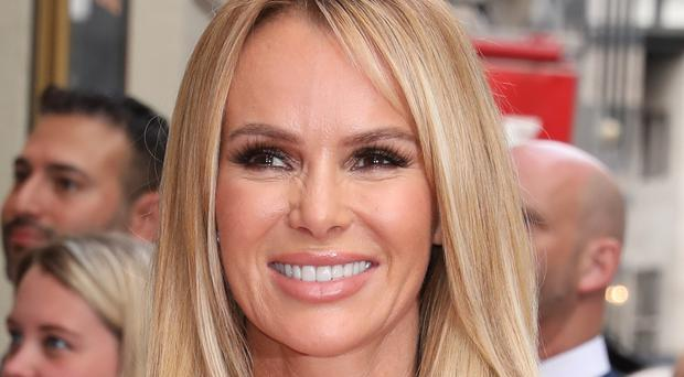 Amanda Holden suffered an injury on holiday (Isabel Infantes/PA)