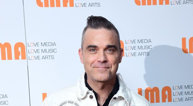 Robbie Williams will sing at this year's Royal Variety Performance (Ian West/PA)