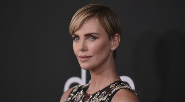 Oscar-winning actress Charlize Theron has welcomed the prospect of gender-neutral categories at award shows (Richard Shotwell/Invision/AP)