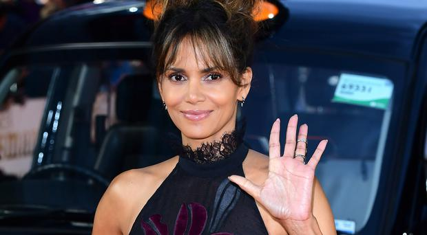 Halle Berry flaunts chiseled ab muscles at 53 a long time old
