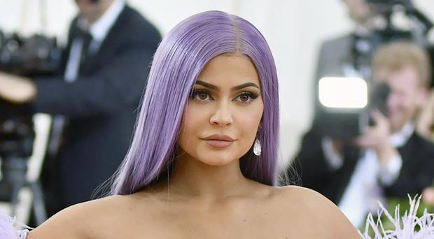 Kylie Jenner has sold a majority stake in her cosmetics business for 600 million US dollars, about £463 million (Charles Sykes/Invision/AP, File)