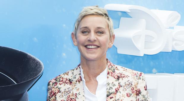Ellen DeGeneres surprised a same-sex couple on her chat show after a newly engaged women said she was rejected by her parents for being gay (David Jensen/PA)