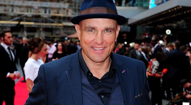 Vinnie Jones thanks Simon Cowell for bringing him on to X Factor (Ian West/PA)