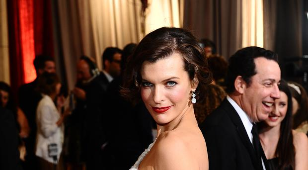 Milla Jovovich's stunt double from a Resident Evil film has dropped a lawsuit against producers after she was injured during filming (Ian West/PA)