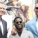 Dwayne 'The Rock' Johnson and Will Ferrell supported Kevin Hart as he received one of Hollywood's oldest honours (Jordan Strauss/Invision/AP)