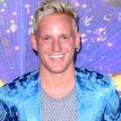 Jamie Laing reacts as his Strictly replacement Kelvin Fletcher wins series (Ian West/PA)