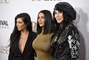 """Kourtney Kardashian, from left, Kim Kardashian West and Cher arrive at the U.S. premiere of """"The Promise"""" at the TCL Chinese Theatre on Wednesday, April 12, 2017, in Los Angeles. (Photo by Chris Pizzello/Invision/AP)"""