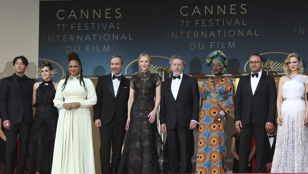 Jury members Chang Chen, from left, Kristen Stewart, Ava DuVernay, Denis Villeneuve, Cate Blanchett, Robert Guediguian, Khadja Nin, Andrey Zvyagintsev and Lea Seydoux pose for photographers upon arrival at the opening ceremony of the 71st international film festival, Cannes (Joel C Ryan/Invision/AP)