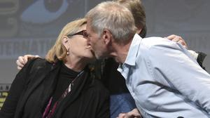 Carrie Fisher and Harrison Ford kiss at Comic-Con International in San Diego last year (Invision/AP)