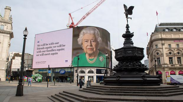 A quote from the Queen's televised coronavirus address, seen on a screen in London's Piccadilly Circus (Dominic Lipinski/PA)