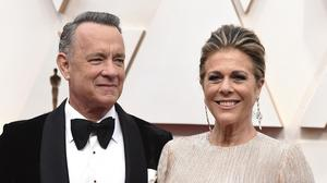"Tom Hanks said he and wife Rita Wilson are taking it ""one day at a time"" after they were both diagnosed with Covid-19 (Jordan Strauss/Invision/AP, File)"
