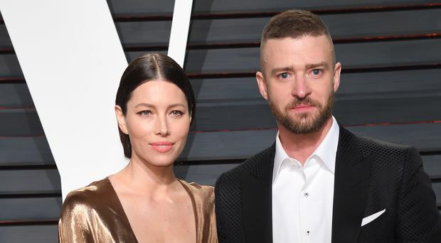 Justin Timberlake has apologised to wife Jessica Biel after he was pictured holding hands with a co-star (PA)