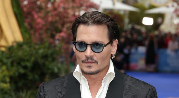 Hollywood actor Johnny Depp has settled a long-running legal battle with a former lawyer (Daniel Leal-Olivas/PA Wire)
