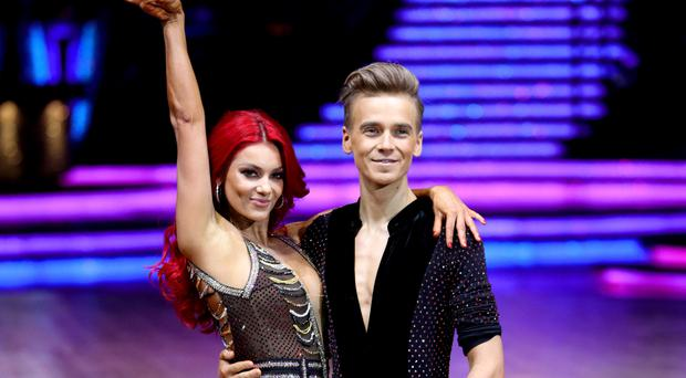 Joe Sugg and Dianne Buswell pose for photographers before the opening night of the Strictly Come Dancing Tour 2019 (Aaron Chown/PA)