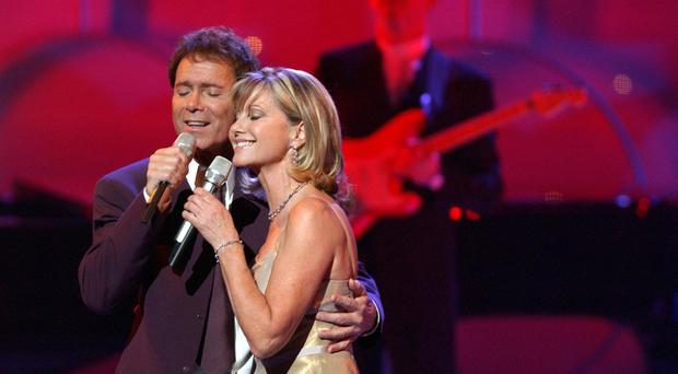 Olivia Newton-John, pictured with Sir Cliff Richard, is best-known for starring in Grease (Andy Butterton/PA)