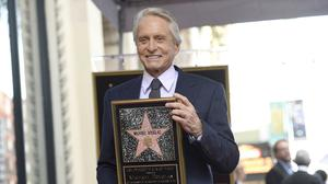 An emotional Michael Douglas was honoured with a star on the Hollywood Walk of Fame (Photo by Chris Pizzello/Invision/AP)