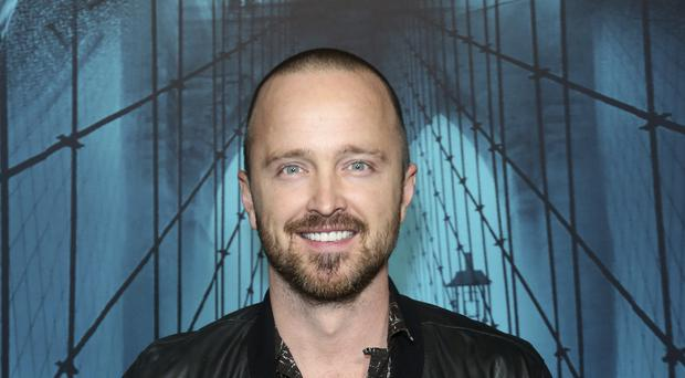 Breaking Bad star Aaron Paul is among those criticising Netflix for a test feature allowing viewers to watch films and TV series at different speeds (Willy Sanjuan/Invision/AP)