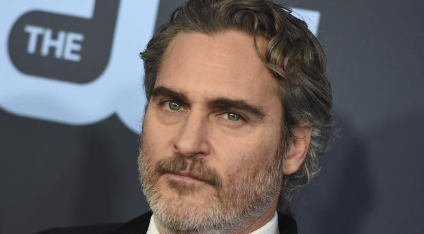 Joaquin Phoenix and Laura Dern were among the early winners at the Critics' Choice Awards (Jordan Strauss/Invision/AP)
