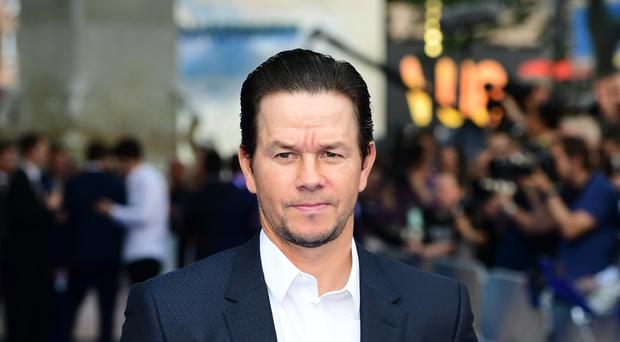 Mark Wahlberg shared a topless snap as he showed off the results of a six-month fitness plan (Ian West/PA)