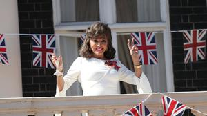 Dame Joan Collins leads The Nation's Toast from the balcony of her apartment in London (Yui Mok/PA)