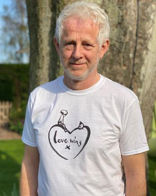Richard Curtis wearing the limited-edition Comc Relief t-shirt to raise money for charities fighting the spread of coronavirus (Richard Curtis/Comic Relief)