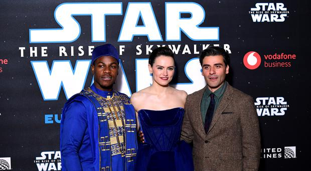 John Boyega, Daisy Ridley and Oscar Isaac (right) at the premiere of Star Wars: The Rise of Skywalker (Ian West/PA)