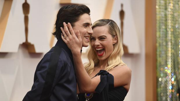 Timothee Chalamet photobombs Margot Robbie on Oscars red carpet (Richard Shotwell/AP)