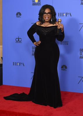Oprah Winfrey poses in the press room with the Cecil B DeMille Award at the 75th annual Golden Globe Awards (Jordan Strauss/Invision/AP)