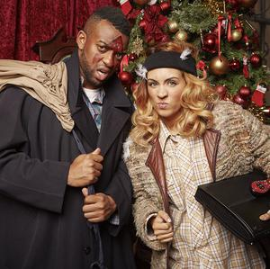 Oritse Williams and AJ Azari pose as characters from Home Alone