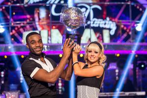 Joanne Clifton and Ore Oduba with the glitterball trophy (Guy Levy/BBC)