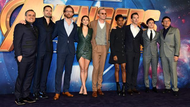 Left to right, Joe Russo, Sebastian Stan, Tom Hiddleston, Elizabeth Olsen, Paul Bettany, Letitia Wright, Benedict Cumberbatch, Tom Holland and Anthony Russo attending the Avengers: Infinity War UK Fan Event held at Television Studios in White City, London (Matt Crossick/PA)