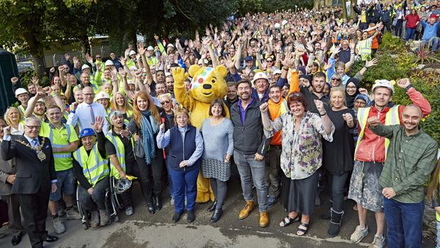 Nick Knowles is joined by the charity Nightsafe and the hundreds of tradespeople and volunteers who gave up their time for the DIY SOS Big Build Children in Need Special (Neil Sherwood/BBC)