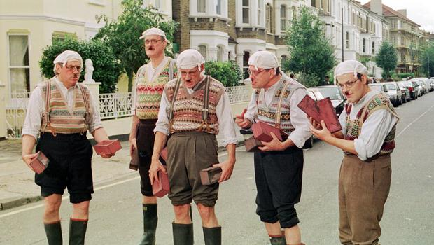Terry Jones with his fellow Pythons, John Cleese, Michael Palin and Terry Gilliam in a sketch with Eddie Izzard dressed as Gumbies in 1999 (Thane Bruckland/PA)