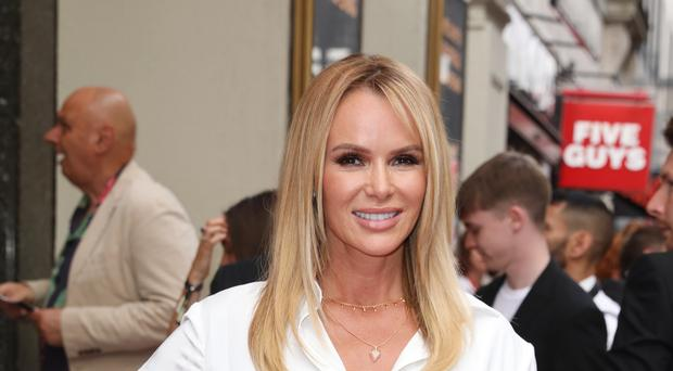 TV presenter Amanda Holden broke her leg in two places following an accident during a family holiday (Isabel Infantes/PA)
