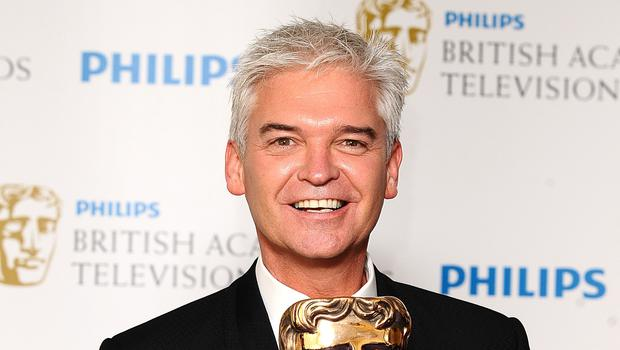 Phillip Schofield's mother has told of her pride in her TV presenter son after he came out as gay (Ian West/PA)