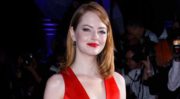Actress Emma Stone is engaged to boyfriend Dave McCary after two years of dating (Matt Crossick/PA)