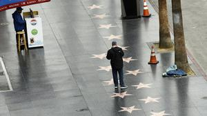 The Hollywood Walk Of Fame, usually one of Los Angeles's busiest tourist attractions, was almost empty amid the coronavirus pandemic (Chris Pizzello/AP)