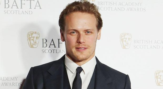 Outlander star Sam Heughan said he was 'so fortunate' to be playing Paul Newman (Jane Barlow/PA)