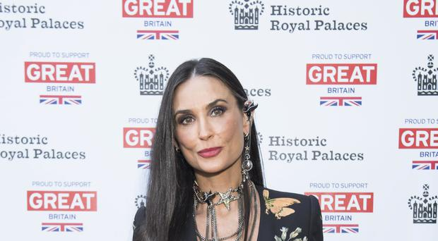Demi Moore has revealed she suffered a miscarriage while dating Ashton Kutcher (David Jensen/PA)
