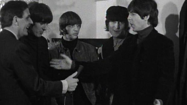 The Beatles make life difficult for the interviewer. (Omega Auctions)