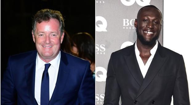 Piers Morgan and Stormzy (PA)
