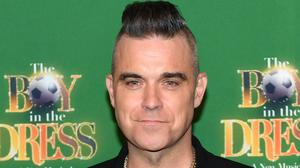 Robbie Williams has revealed his father has been diagnosed with Parkinson's disease (Jacob King/PA)