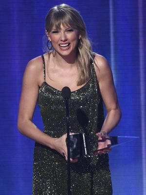 Taylor Swift won six awards on the night and was all smiles as she accepted the gong for favourite pop/rock album for Lover (Chris Pizzello/Invision/AP)